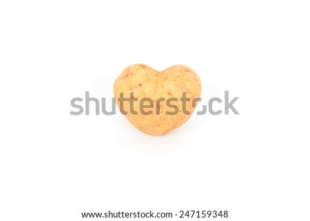 fresh potato tuber with the heart form - stock photo