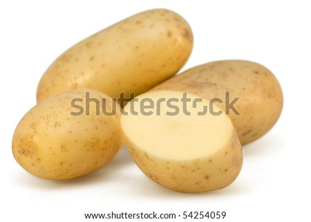 Fresh potatoes and slices on white background isolated