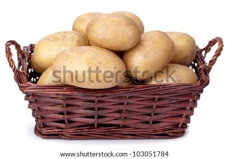 Fresh potatoes in basket - stock photo