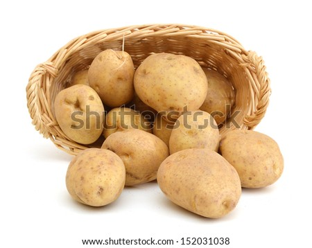 Fresh potatoes in basket isolated on white  - stock photo