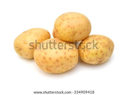Fresh potatoes on a white background - stock photo