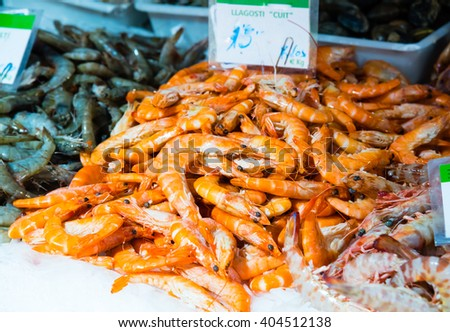 fresh prawns on display at a market - stock photo