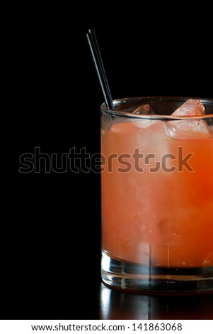 fresh pressed ruby red grape fruit juice isolated on a black background
