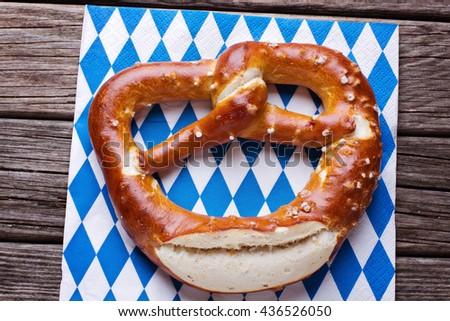 Fresh pretzel on napkin - stock photo