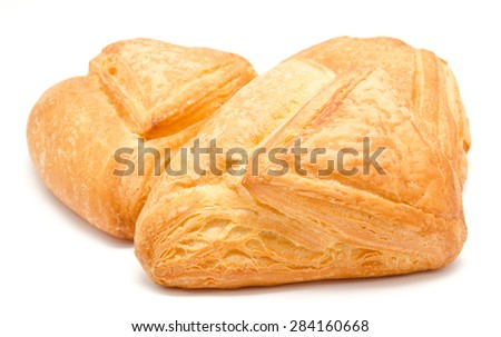 Fresh puff pastry isolated on a white background