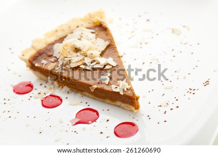 Fresh Pumpkin Pie with Berries Sauce - stock photo