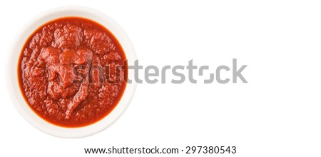 Fresh pureed tomato in white bowl over white background