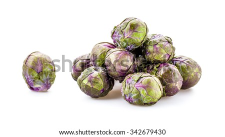 Fresh Purple Brussels sprouts on a background