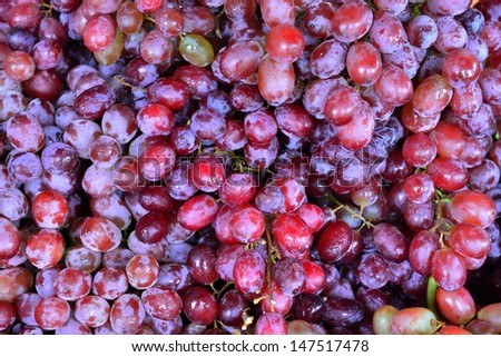 Fresh purple grapes background - stock photo