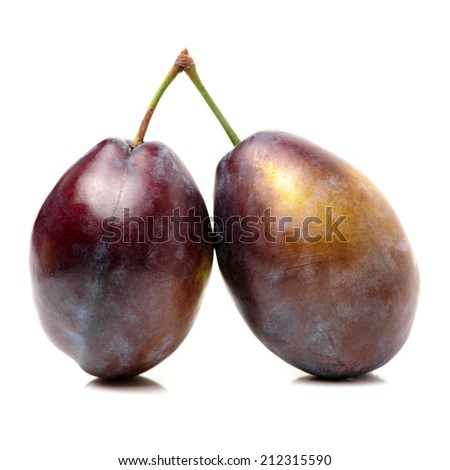 Fresh purple plums on the white background