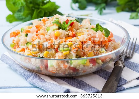 fresh quinoa salad taboule style with vegetables on bowl