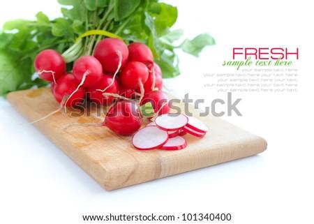 Fresh radish on a wooden board isolated on white background - stock photo