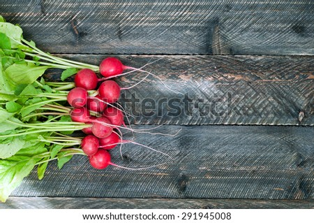 Fresh radish on old wooden table. Radish background. Rustic Style.  - stock photo