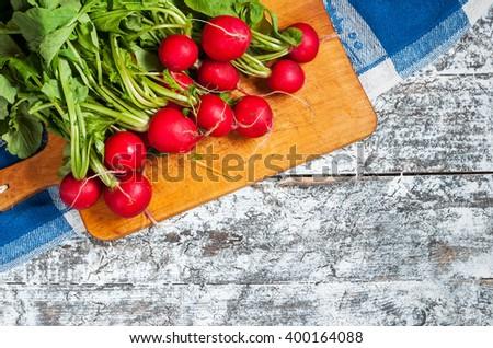 Fresh radish on old wooden table. Radish background. Rustic Style. - stock photo