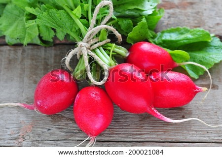 Fresh radish on wooden table  - stock photo