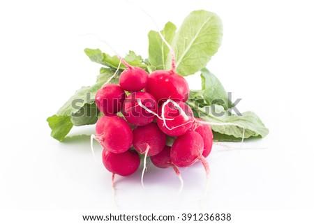 Fresh radishes isolated on white. - stock photo