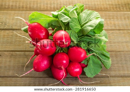 Fresh radishes on a wooden table - stock photo