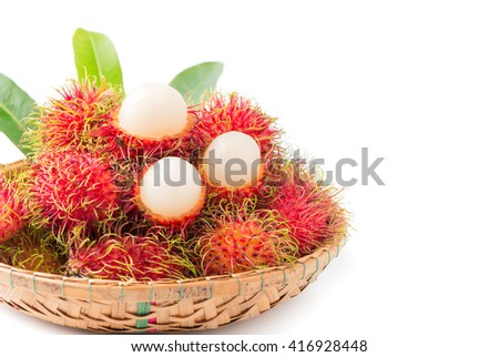 fresh rambutan in bamboo basket isolated on white
