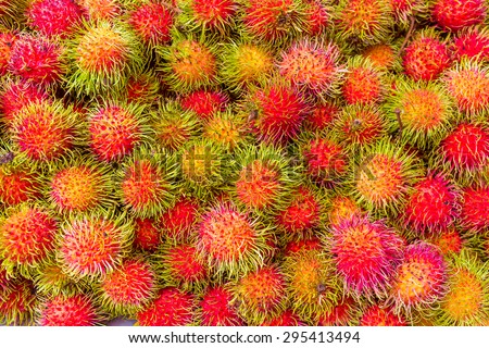 Fresh rambutans background - stock photo