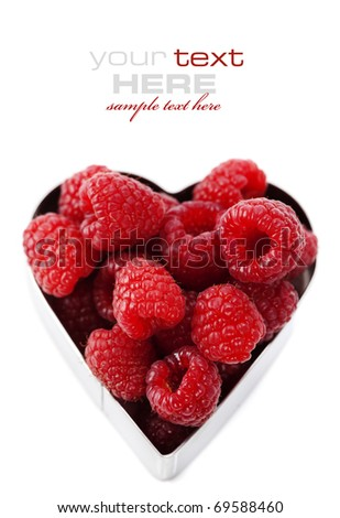 fresh raspberries in a heart shape representing love and valentines day images (easy removable text) - stock photo