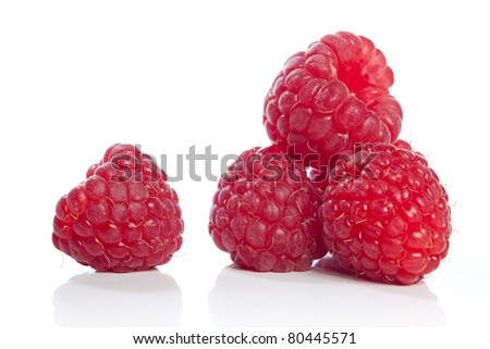 Fresh raspberries isolated against a white background