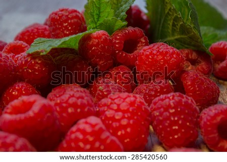 fresh raspberries on wooden background