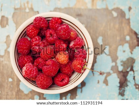 Fresh  raspberry on wood background - stock photo