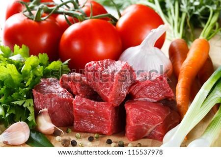 Fresh raw beef on cutting board - stock photo