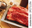 Fresh raw beef on kitchen table - stock photo