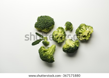 Fresh raw broccoli isolated on a white background. - stock photo