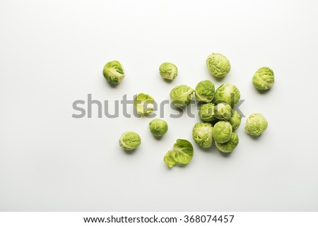 Fresh raw Brussels sprouts isolated on a white background.
