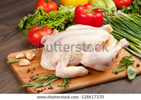 Fresh raw chicken and vegetables prepared for cooking - stock photo