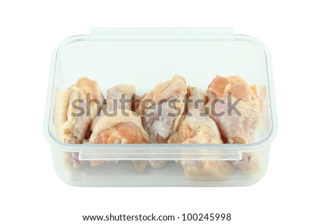 Fresh raw chicken wing in package. - stock photo