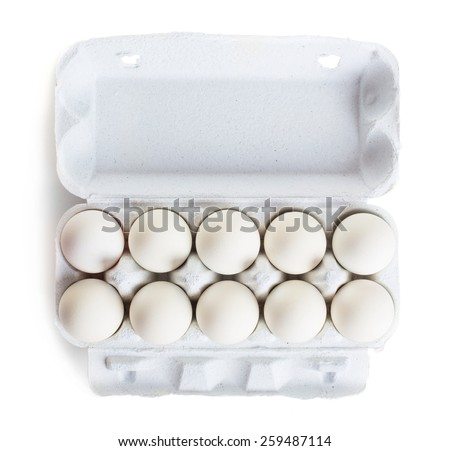 Fresh raw eggs in box isolated on white background - stock photo