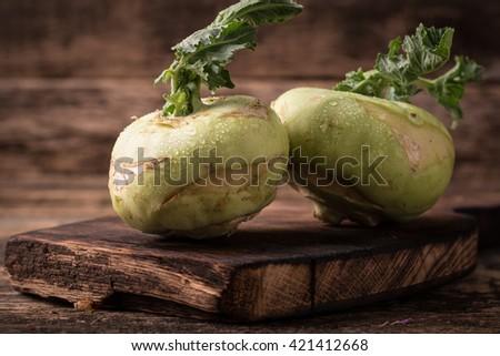 Fresh Raw Kohlrabi Vegetables On A Rustic Wood - stock photo