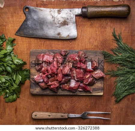 Fresh raw lamb chop on a cutting board for meat cleaver Meat fork herbs top view close up  on wooden rustic background - stock photo