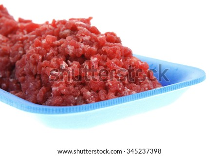 fresh raw mince beef meat on blue tray isolated over white background - stock photo