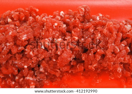 fresh raw mince beef meat on red tray isolated over white background - stock photo