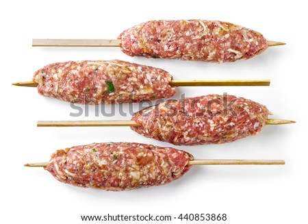 fresh raw minced lamb meat skewers isolated on white background, top view - stock photo