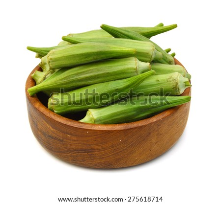 Fresh raw okra isolated in wooden bowl on white background - stock photo