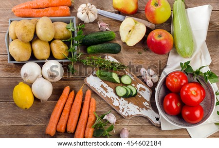 Fresh raw organic vegetables and fruits. Healthy Food background. Diet eating. Top view