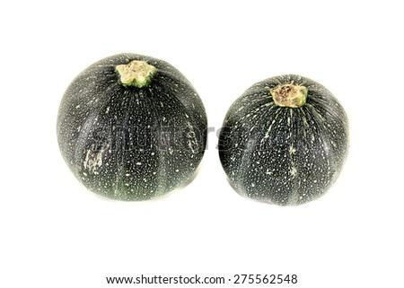 fresh raw rotund zucchini on a light background - stock photo