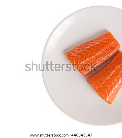 Fresh Raw Salmon Red Fish Steak on a dish isolated on a White Background