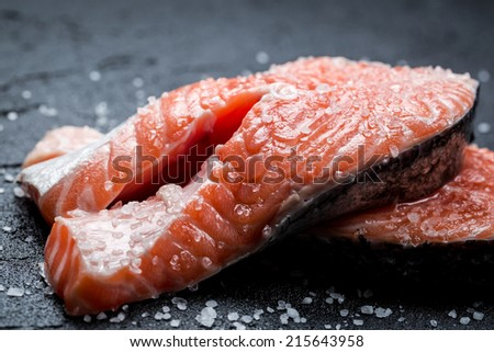 Fresh raw salmon with coarse salt