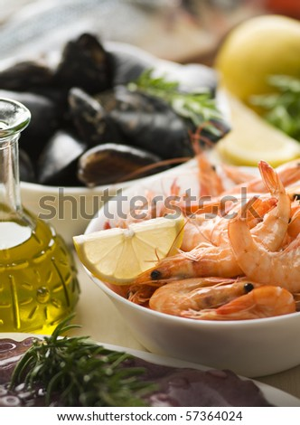 Fresh raw seafood with herbs close up shoot - stock photo