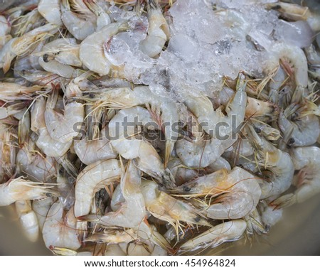 Fresh raw shrimps seafood in ice for sale in a local market in Thailand