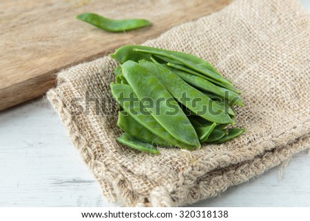 Fresh raw snow peas for an healthy meal - stock photo