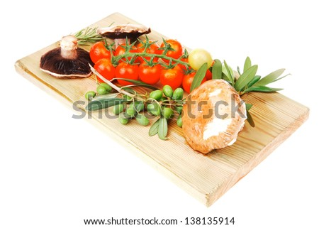 fresh raw vegetables served on wooden board - stock photo