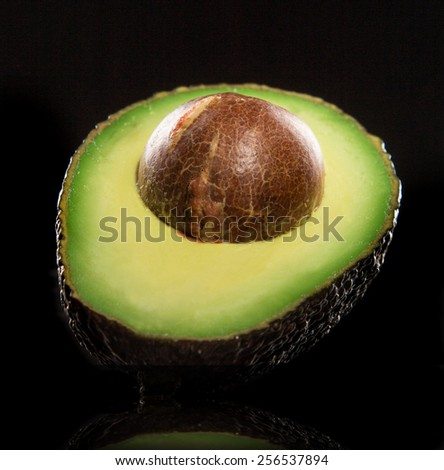 "fresh ""ready to eat"" avocado on black background - stock photo"