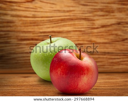 Fresh red and green apple on wooden background - stock photo